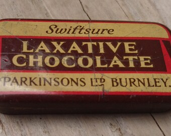 Vintage tiny tin of laxative chocolate