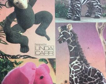 Vogue 8340 UNCUT Stuffed Monkey Elephant Zebra and Giraffe Jungle Stuffed Animals by Linda Carr Sewing Pattern FF