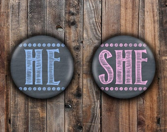 Chalkboard He and She pins.  Light Pink and Light Blue.