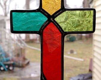 Stained Glass Cross- Crucifix Suncatcher - Multi colored orange, amber, blue and green.