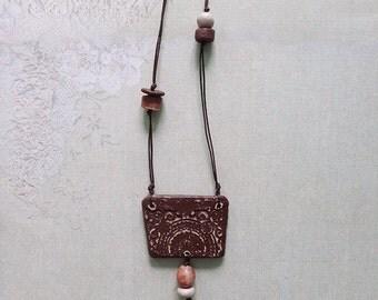 Trapezoid burgundy ceramic unique handmade pendant, necklace with beads.