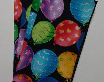 Set of 4 Party Balloon dinner napkins with multi colored balloons.