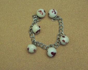 Sterling silver charm bracelet vintage white glass oxblood buttons