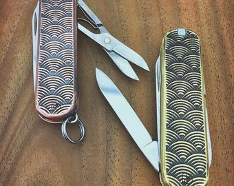 Embossed aged seigaiha (wave) pattern Victorinox Classic SD pocket knife