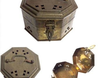 19th century brass Chinese cricket box. This octagon box sits on four rounded legs and had an intricate handle at the top.