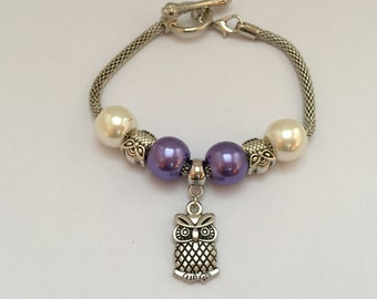 Bracelet charm's, purple and white, with charm owls REF. 811