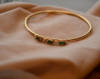 Stunning and regal vintage 14K yellow gold hinged bangle bracelet with marquise emeralds and diamonds