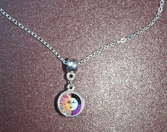 Silver necklace with red sun and half moon-sun pendant. Chain is 8 inches (21 cm) in length.
