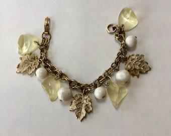 Shades of white charm bracelet