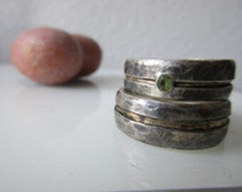 Wedding rings with Peridot, silver and gold of green Weddingrings
