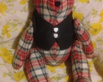Homemade flannel bear in a vest