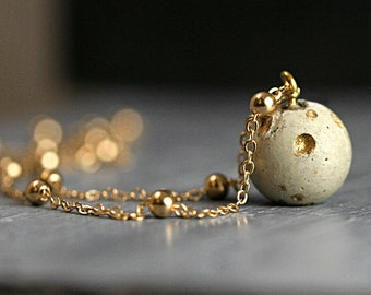 New: Concrete & Gold planet moon necklace. Delicate concrete full moon with crater landscape and satellite necklace. Dainty solar system.