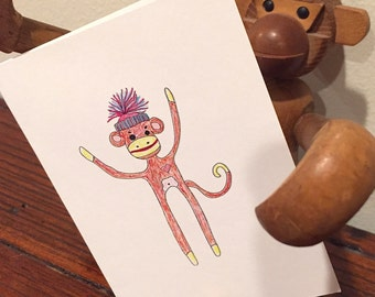 "SOCK MONKEY. this card will come as a sock to everyone. say ""hey, monkey"" or ""sock it to 'em."" for peter gabriel fans: ""sock the monkey."""