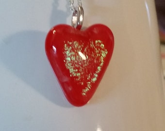 Irridized red heart necklace.