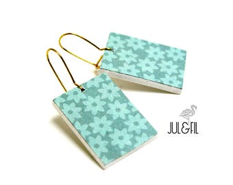 Graphic flowers turquoise and blue celadon wood sleepers, brass