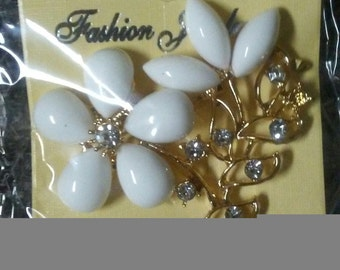 Gold Tone and White Resin Flower Pin With CZ Stone Accents