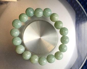 Vintage Chinese translucent light green jadeite jade beaded bracelet