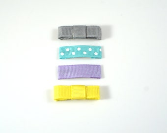 Grey, Purple, Yellow. Baby Hair Clips. Baby Snap Clip. Tiny Baby Hair Clip. Tiny Baby Snap Clip. Baby Barrettes. Baby Bow Set. Small Bow Set