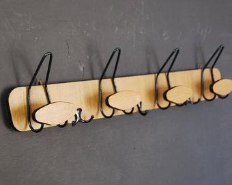 French vintage coat or hat rack in classic 70s design, double row of hooks , faux bois laminated finish on hardboard