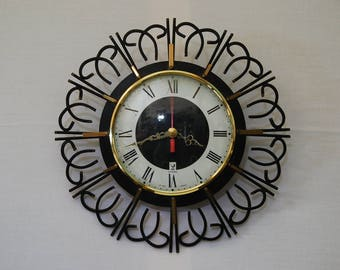 French 1960s kitchen clock, made by Jaz. This neat sized clock is very retro,  funky black metal surround. Found in its orginal box.