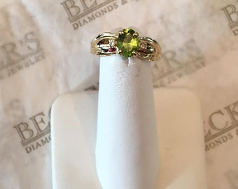 Vintage 14k yellow gold Oval Peridot & 2 Diamond Ring, .73 tw, size 7 with Pinched Ribbon Top