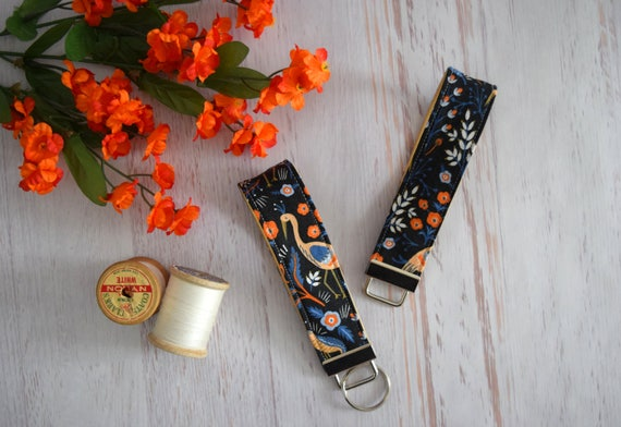 Rifle Paper Co Key Fob. Navy and Orange Floral Key Holder with Silver Ring. Wrist Fob Handmade with Cotton Fabric and Tan Vinyl Interior.