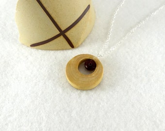 Wooden pendant, wooden ring and hanfelted wool black and red pearl