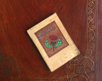 Cork leather/cork fabric passport cover in natural fawn with the design of a thistle backed in coloured leather