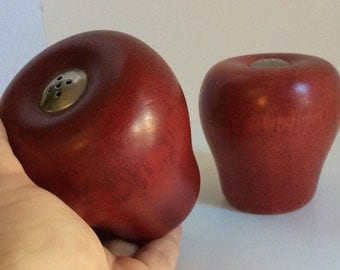 Vintage 70's Apple salt and pepper shakers. Made of solid wood.