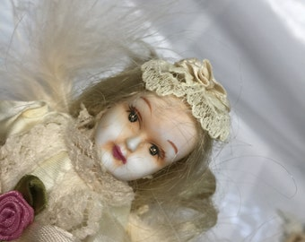 White porcelain Christmas doll with long lace dress - Blonde hair - painted face