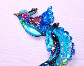 Paradise bird brooch hand carved from stones and beads