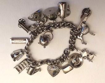 Articulated silvertone charm bracelet
