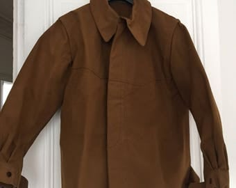 The 1970s in thick tobacco color cotton work jacket. Size L. true vintage