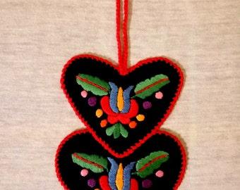 Double-heart-shaped hand-embroidered ornament, tree hanger (Hungarian, Matyo motifs) (MKORN-NEEDLEHEART-PAIR-263)