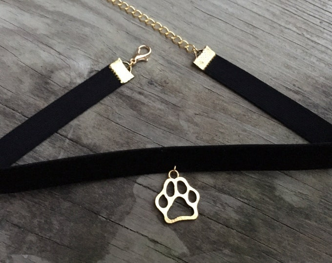 PUPPY LOVE: black velvet and antique gold paw choker