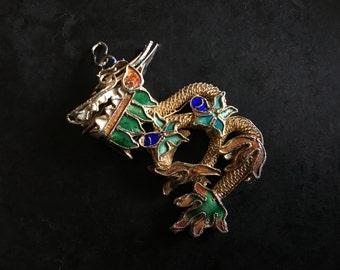 Chinese export gilt filigree dragon pendant with enamel embellishment.