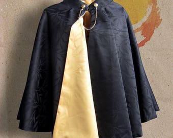 Small black and yellow reversible cape