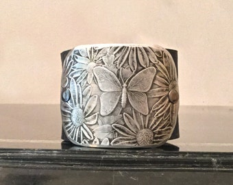 Vintage Retro 70's Pewter Silver Butterfly and Daisy Buckle Cuff Bracelet - Signed Wendell August, Upcycled & Repurposed On Black Leather
