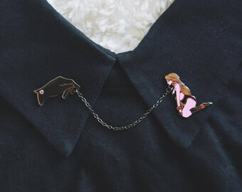 The Hand That Leads Enamel Pin