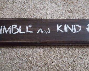 Wooden sign with quote humble and kind