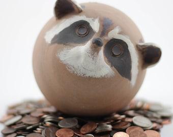 Curious Raccoon Coin Bank