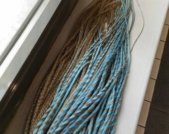 Set of braided dreads and twisted dreads. Twists glowing in the dark with blue. Twists and braid dreads, 2 colours, blue and blond