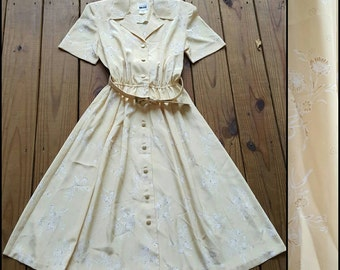 Vintage 6P Medium Small pale yellow floral button up short sleeve midi dress with matching yellow floral belt. Gold hardware. Has collar.