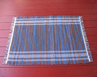 Handwoven cotton rug blue brown