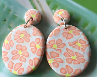 Orange flower print dangles