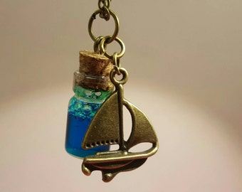 Glass vials with ship pendant on bronze chain