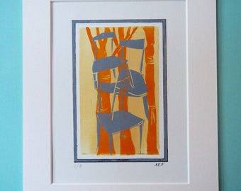 Linocut print of midcentury g-plan chair and beechwoods in orange and grey. Limited edition run of 8.