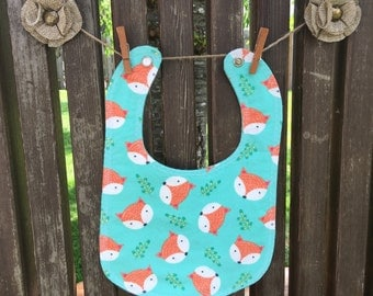 Foxy Flannel Bib with pearl  snap fastener and decorative edge stitching