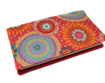 Red checkbook in colorful fabric