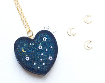 Resin heart shaped charm, with Moon and stars in the night sky